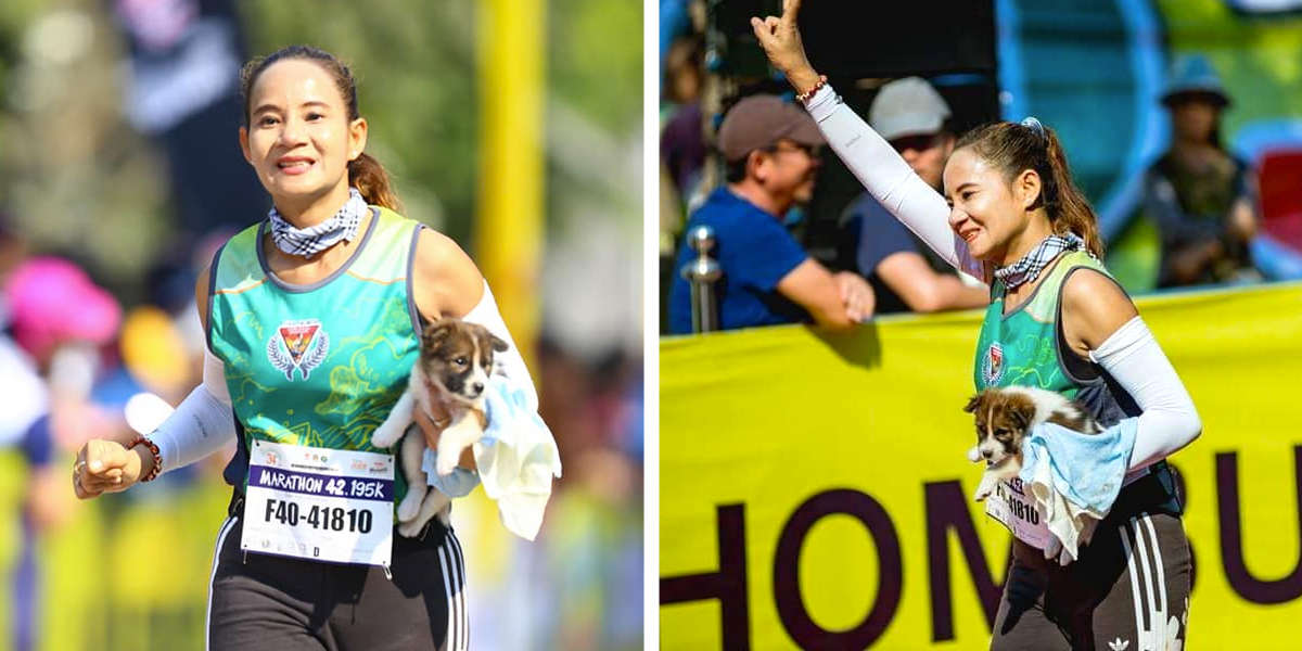 Mulher acaba maratona carregando cão que salvou durante a corrida